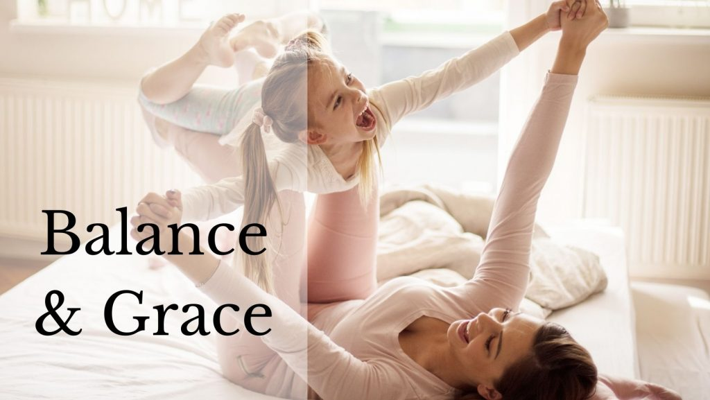 """A mother and daughter playing. The mother is holding the daughter, balancing her. The text reads """"Balance & Grace."""""""