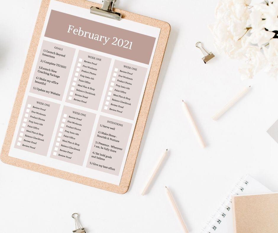 February 2021 goals & to-do lists on a white desk