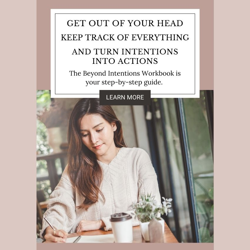 Get Out of Your Head, Keep Track of Everything, and Turn Intentions Into Actions. The Beyond Intentions Workbook is your step-by-step guide. Below the text is a photo of a woman sitting in a coffee shop. She has a to-go cup of coffee in front of her, and she is writing in a notebook. She looks content and intentional. A small green plant decorates the table.