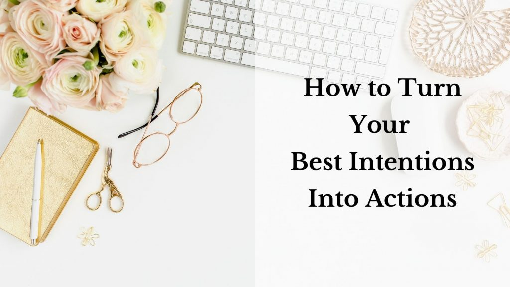 """A flatlay of gold-colored desk accessories. A notebook, scissors, glasses, paperclips. A bouquet of flowers and a white keyboard. A white mouse is visible under the text. The text reads """"How to turn your best intentions into actions."""""""