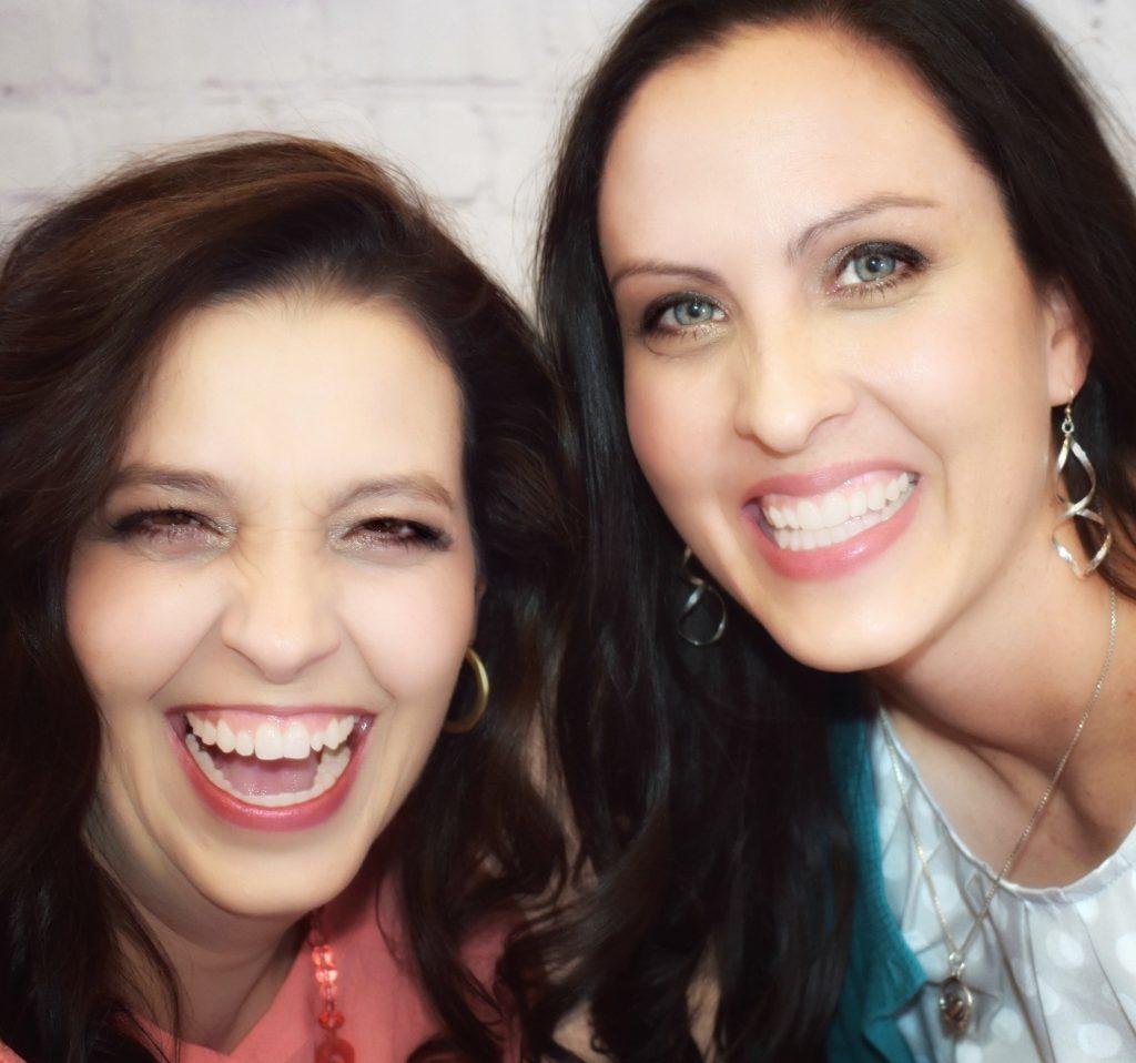 Kelli and Jamie smiling wide. Both look happy.