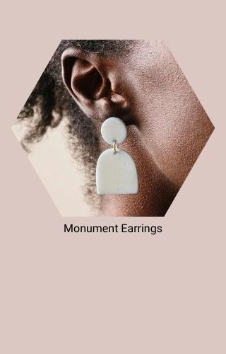 Monument Earrings. (A white, sculptural pair of earrings comprised of a round stud and an arch-shaped drop)