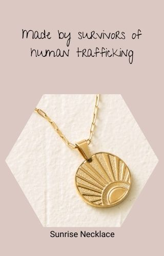 Sunrise Necklace (a gold chain with a round pendant with a sun emblazoned on it) Made by survivors of human trafficking
