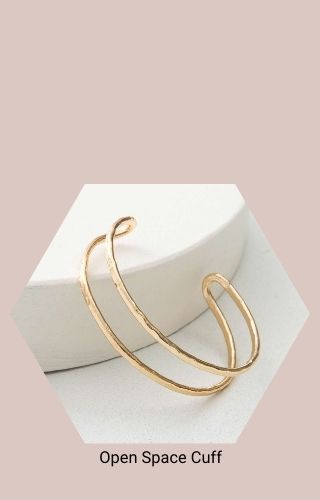 """Open Space Cuff (a cuff bracelet made of two thin, gold strips about 1/2"""" apart.)"""