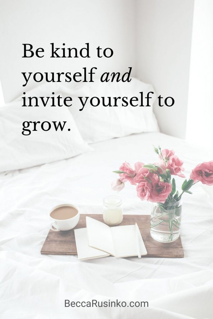 Be kind to yourself and invite yourself to grow. [The decorative image shows a bed with white crumpled sheets. A tray has been placed on the bed with a notebook, a candle, a cup of coffee, and a vase of flowers. The vibe is cozy and reflective.]
